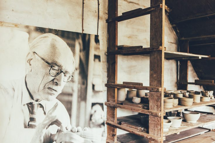 Pottery and portrait of Bernard Leach
