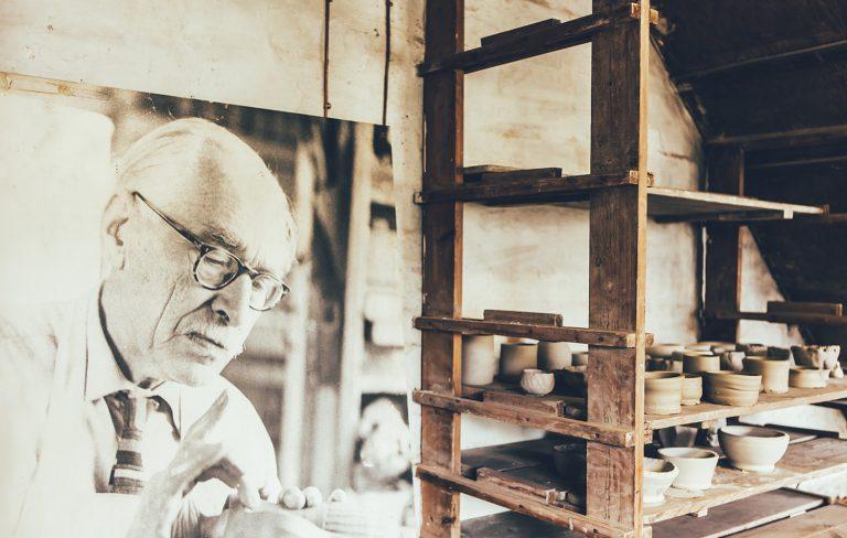 Pottery and portrait of Bernard Leach
